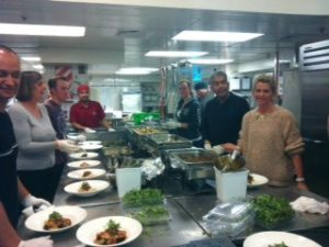 The team, including CEO, Director of Finance and 700 hot, hot plates!